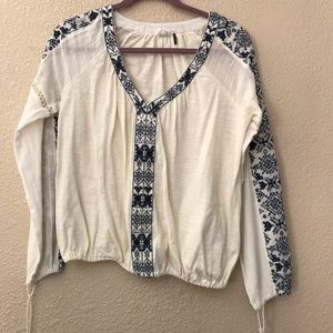 Blue and white embroidered blouse